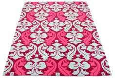 "A damask hand tufted pure wool rug with red, rasberry and turqoise white colours. It has a pile depth of 12-14mm. Created using the ""Prince Charming"" design."