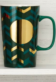 Ceramic coffee mug with a chevron design, green exterior, and metallic accents. #Starbucks #DotCollection