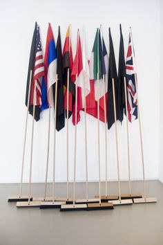 Mounir Fatmi,G8-The Brooms (Contamination), 2008,12 wood sticks 3 meters high, 8 national flags and 4 black flags (150 x 100cm each), courtesy of Lombard Freid Projects. #art #contemporaryart