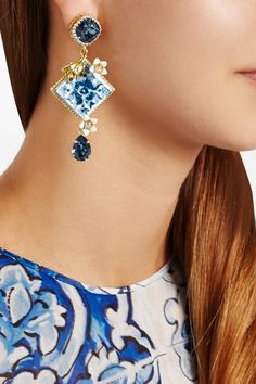 Dolce & Gabbana|Gold-plated Swarovski crystal clip earrings|Dolce & Gabbana's gold-plated brass earrings are decorated with a tonal-blue and white resin tile inspired by Italian Maiolica pottery - a key motif in the label's collection. They are set with Swarovski crystals for a beautiful light-catching effect. Presented in a black velvet box, they'll make the perfect gift for admirers of the brand.