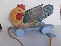 Wooden Rooster on Wheels Primitive Folk Art Pull Toy by tjmccarty
