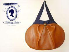 Big shoulder bag in leatherette and serge.  Original pattern.