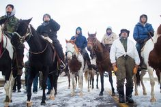 """""""I ain't going nowhere,"""" one man said as he and fellow protesters on the frozen prairie prepared for what they believe may be their last stand."""