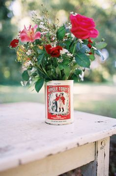 Instead of the current pic on the can, make it from an old sideshow ad like conjoined twins or the Fiji Mermaid. Something whimsical and macabre. Different flower selections.