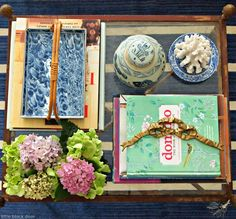 blue and white coffee table styling: The Little Black Door