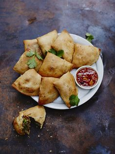 Brilliant as a snack, this baked samosa recipe from Jamie Oliver is fun to make and packed with flavour. A vegetable samosa recipe you'll make all the time. Samosas, Empanadas, Vegetable Samosa, Vegetable Recipes, Indian Food Recipes, Vegan Recipes, Cooking Recipes, African Recipes, Turkish Recipes