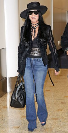 Cher, Has Been Wearing Bell Bottoms and Wacky Hats to the Airport for More Than 40 Years — People 70s Fashion, Vintage Fashion, Fashion Outfits, Divas, Cher Concert, Cher Photos, 70s Mode, Cher Bono, Woman Outfits