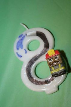 Sick Bricks birthday candle. Attached Smokey Burns to a #8 candle and drew on a water hose ;)
