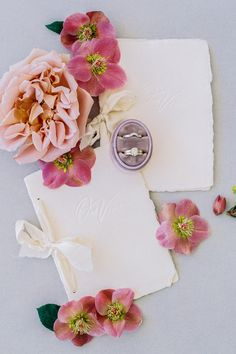 "From the editorial ""This Bride's Bouquet Filled With Ranunculus, Pansies, and Surreal Hellebores Is an Instant Mood Booster."" The bows on these vow booklets are the perfect final touch for an elegant and dainty overall feel.  LBB Photography: @nataliebrayphoto Vow Booklets: @plumecalligraphy  #vowbooks #vowbooklets #vows #weddingvows #weddingstationery Original Wedding Invitations, Affordable Wedding Invitations, Wedding Invitation Inspiration, Wedding Ring Box, Wedding Vows, Wedding Ideas, Vow Booklet, Custom Wedding Gifts, Bridal Show"
