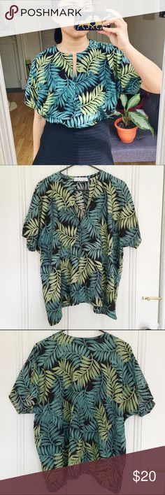 Vintage Floral Green Leaf Blouse Perfect condition one size fits all top that is perfect tucked over aa pair of jeans or with a black skirt (like pictured). Bring this to festival season or to brunch. Tops Blouses