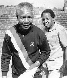 ANC deputy president Nelson Mandela leads Umkhonto we Sizwe chief of staff Chris Hani to face the media at the Mandela home in Orlando West yesterday.