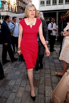 Theresa May in a red dress attends the private view of the Royal Academy Summer Exhibition in London, in 2013.