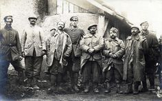 Five 'trophy' French Prisonniers de Guerre are photographed with their Bavarian captors