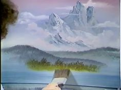 """Bob Ross introduces us to his """"Almighty"""" assortment of tools and colors, tells us that anyone can paint, and creates a landscape of a forest path just after ..."""
