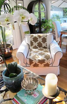 """I know that's a blanket in the chair but it makes me think of a """"chair runner"""" like a tablecloth runner ... interesting / novel way to bring more pattern into a room when recovering a chair isn't an option"""