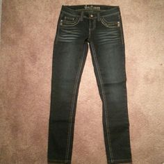 Dark Wash Denim Skinny Jeans Maybe worn once if at all! Cute studded details on the pockets wall flower Jeans Skinny