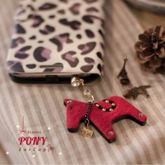 Dangling Pony Phone PlugHappyMori specializes in quality cell phone cases designed at the design studio in South Korea. You