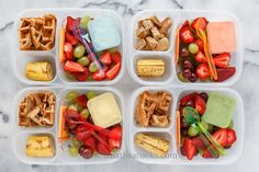 Waffle bites, banana, strawberries, grapes, and cheese. One has whipped cream for dipping, one has cottage cheese, two have yogurt.Packed in Easy Lunchboxes .