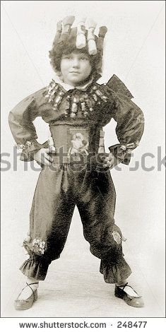 Vintage Photo of a Child In Circus Costume by chippix, via Shutterstock