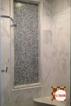 And doesn't the mosaic in the recessed panel finish off this shower beautifully?