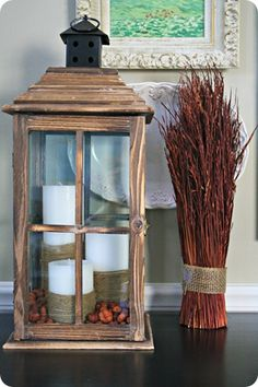 entryway composition: artwork, platter, lantern with cord-wrapped candles and mini pumpkins (try with acorns!)