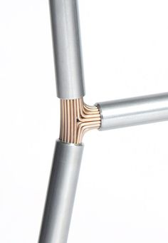 Structural frames by Alex Cashmore. Metal wire, copper, brass, into tube, aluminium, steel, chair