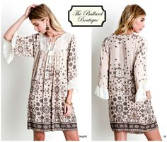 Beautiful taupe print with lace detail. www.theballardboutique.com