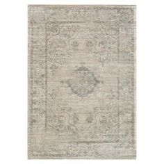"""Anchor your dining set or living room seating group in style with this art silk rug, showcasing a weathered Persian motif in beige and blue.   Product: RugConstruction Material: 100% Art silkColor: Beige and blueFeatures:  Power-loomed0.25"""" Pile height Note: Please be aware that actual colors may vary from those shown on your screen. Accent rugs may also not show the entire pattern that the corresponding area rugs have.Cleaning and Care: Clean spills immediately by blotting with a clean ..."""
