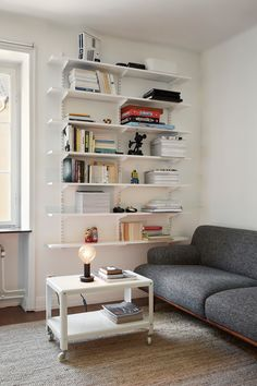 Ikea 'PS 2012' side table & 'Algot' shelving system