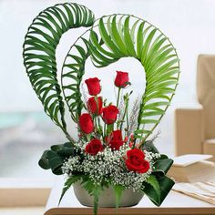 Unique arrangement with roses and palm leaves