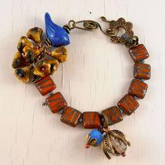 handmade bracelet, handmade beaded bracelet, orange bracelet, unique bracelet, ooak jewellery, bird bracelet, fall coloured jewellery by Songbead