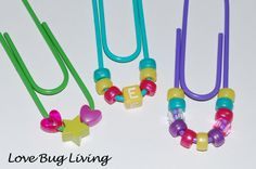 Cute....not sure what the function of them would be....maybe move the beads to the other side of the giant paperclip and then it would be an easy-to-make bookmark????