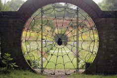 love this spiderweb garden door.  complete with a spider.