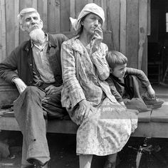 Portrait of married couple Hark (left) and Ollie Hatfield, and their son (unnamed), as they sit on a porch, West Virginia, 1944. From the Tug Fork area, they are descendants from one of the families involved in the long-running (but long finished) Hatfield-McCoy fued. Hatfields And Mccoys, Descendants, Back In The Day, West Virginia, American History, Sons, Portrait, Couples, Life
