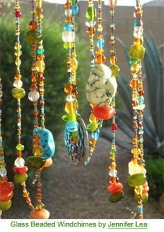 They shine and shimmer, glitter and glimmer. They catch the sunlight and glow at twilight. Crystal baubles, gem stones, acrylic and glass beads can add as much dazzle to your garden decor as they do to your jewelry collection.