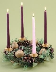 The advent wreath, four candles on a perfect circle of evergreen to symbolize the eternity of Christ. Three purple candles, one for each week in advent are used with a white candle in the middle as Christ's candle or one pink to represent joy. The first candle symbolizes expectation the second lighting symbolizes hope, the third joy and the fourth purity. The last candle is lit on Christmas Eve or Christmas Day reminding Christians that Christ is the light of the world. Find your joy, Dina