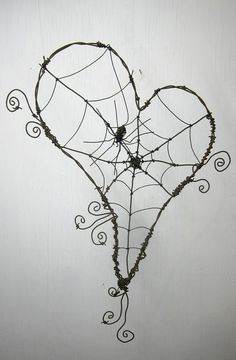 Wire wrapping practice - large scale before I move to smaller jewelry.  Not big on hearts.  Pumpkin shape?  Witch hat?  Cat shape would be fun.  Maybe a really, really big one for the garden fence.