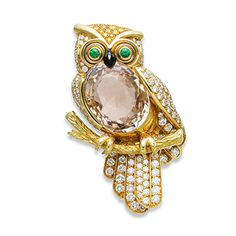 A GEM-SET, COLORED DIAMOND AND DIAMOND NOVELTY BROOCH, BY CARTIER, MODELED AS An OWL WITH ORANGE SAPPHIRE, EMERALD AND DIAMONDS