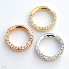 """Eternity"" seamless septum clickers in 14-gauge, 14k yellow, white, and rose gold, from Venus by Maria Tash."