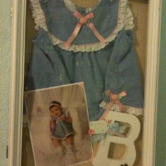 love the idea of shadow boxes with favorite baby outfits!