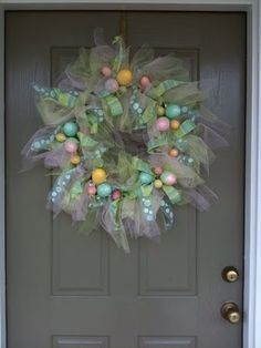 Easter Wreath - so cute but I would have to hang indoors - I can only imagine what it would look like after the birds and apparently squirrels walked off with the pretty ribbons and tulle
