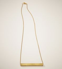 Nyla Brass Necklace | The rectangular tube charm on this neckalce takes a simple pie... | Necklaces