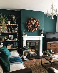 Green accent wall and fireplace in the living room with vintage fireplace and door . - house decoration Green accent wall and fireplace in the living room with vintage fireplace and … Dark Green Living Room, Dark Living Rooms, Living Room Accents, New Living Room, Home And Living, Living Room Accent Wall, Green Living Room Ideas, Small Living, Living Room Decor Ideas With Fireplace