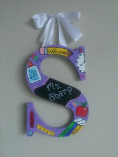 Letter Door hanger for teacher made by A and S Designs. Www.facebook.com/aandsdesignsforyou Teacher Door Hangers, Letter Door Hangers, Teacher Doors, Teacher Name Plates, Letter To Teacher, Teacher Appreciation Gifts, Teacher Gifts, School Wreaths, Decorated Letters
