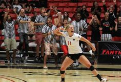 Ali Rook and Fanthers cheer with enthusiasm at an intense game of DU volleyball.