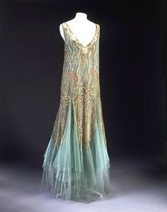 Worth - Evening dress1928-29. Hand-sewn tulle, with hand-embroidered iridescent sequins. http://collections.vam.ac.uk/