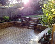 photo of split-level garden and decking railway sleepers raised borders