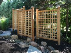 A trellis not only adds beauty to your landscape but function as well. This grouping provides a private and intimate space. We offer custom Cedar Trellis and Pergola design, construction and installation.