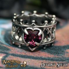 Alchemy Gothic AG-R156 Elizabethan Ring  A pierced pewter band ring in late gothic style heart tracery, set with a Swarovski amethyst crystal heart.