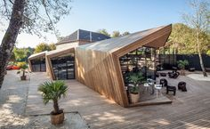 Boos Beach Club Restaurant, Metaform architects, refurbished architecture, green renovation, beach bar, Luxembourg, origami, wooden structure, concrete, green architecture, outdoor terrace